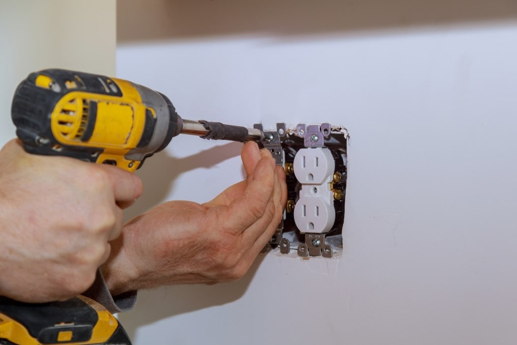 electrician installing an outlet