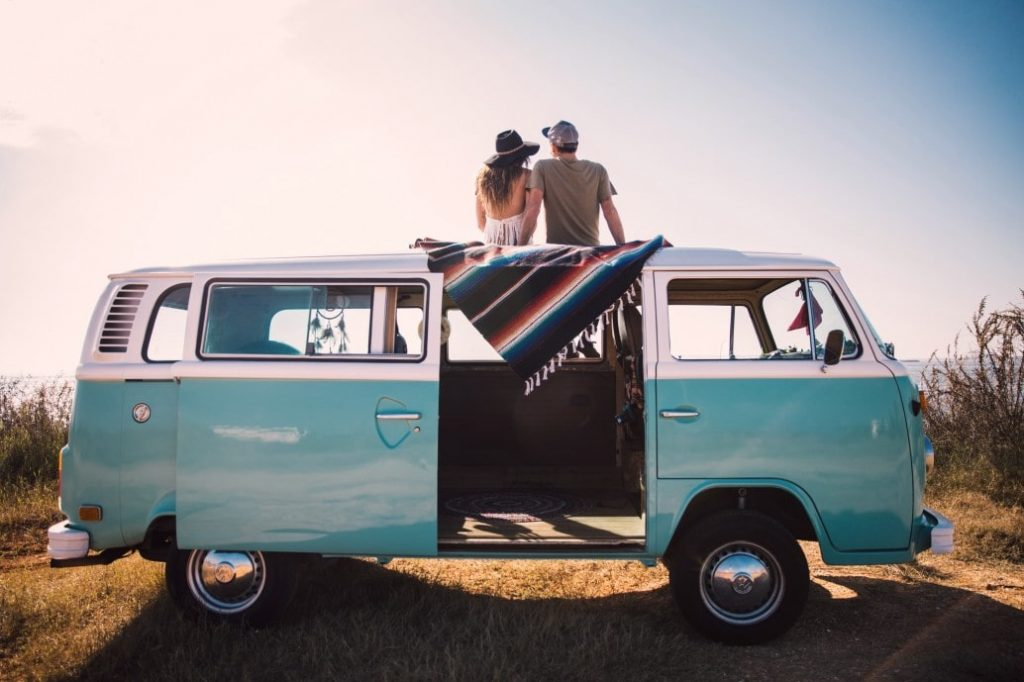 couple traveling in a small van
