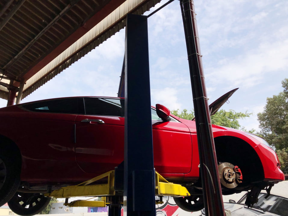 red car lifted off the ground