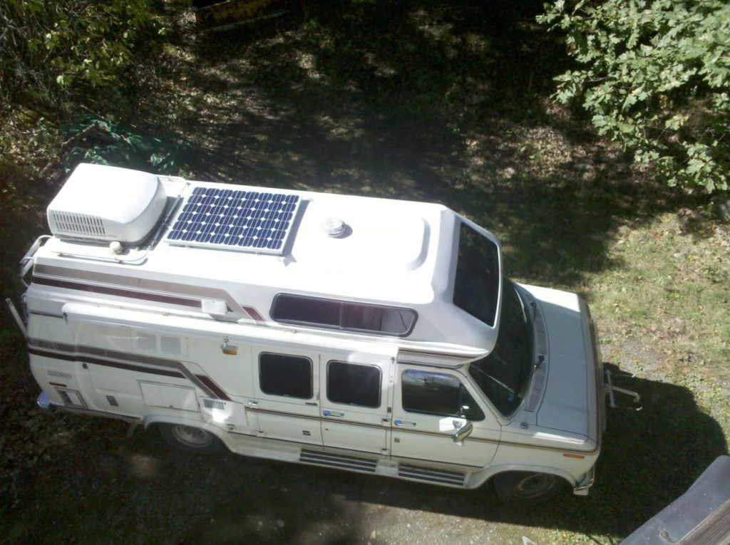 look at a camper with a solar panel