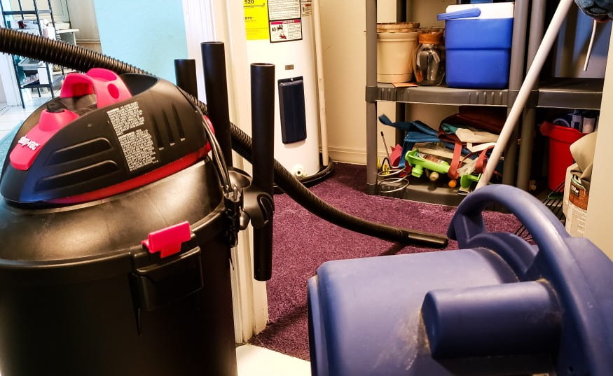 shop vac in dirty room