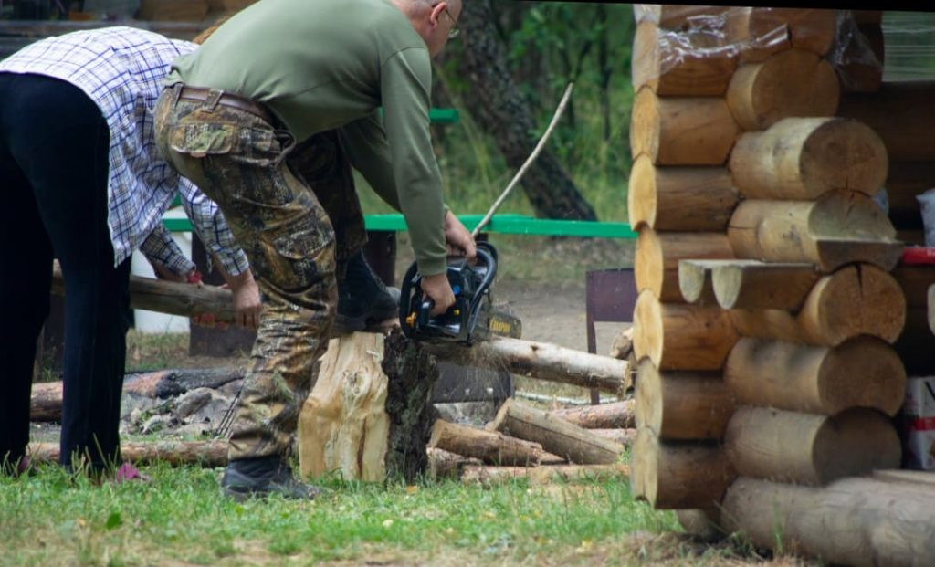 wood being cut with a chainsaw