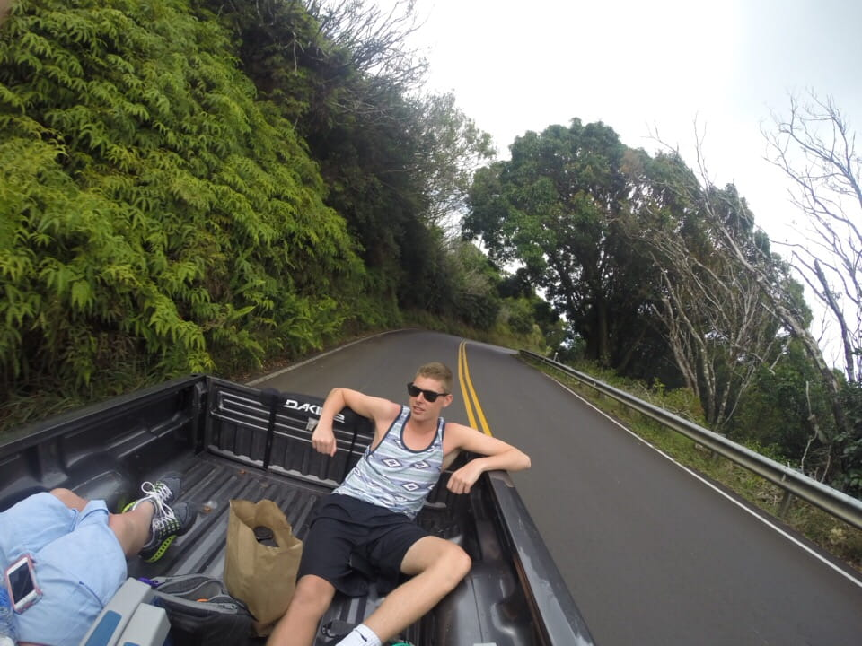 guy sitting in the back of a truck bed