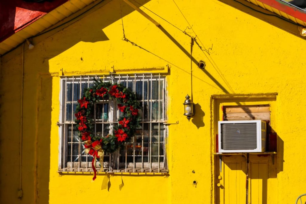 yellow house with an air conditioner