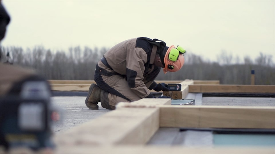 A worker doing laser leveling work